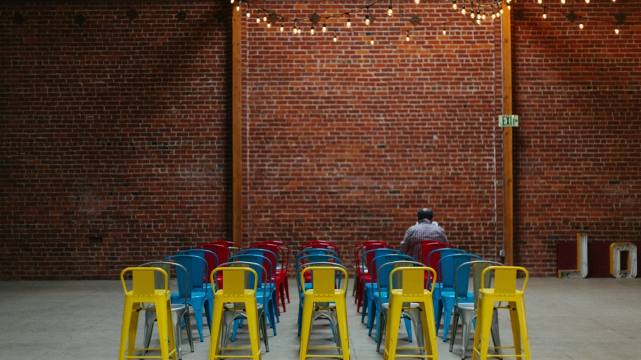 Brick wall with chairs in Ethics of Ownership